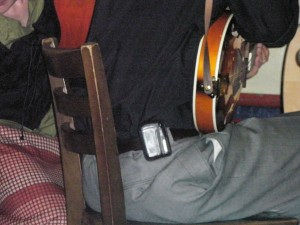 Mandolin player with cell phone on hip